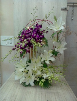 10 purple Orchids 10 white Orchids and 7 white lilies Basket