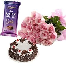 12 pink roses 1/2 kg black forest cake 1 silk chocolate