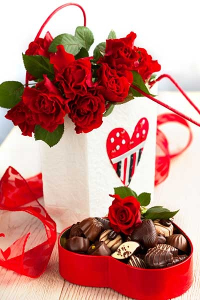 12 Red roses in Basket with Heart shaped chocolate box