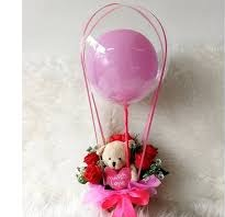 6 Red rose Teddy in basket with single pink balloon inside a transparent Balloon