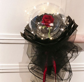 Transparent balloon with 1 red rose black wrapping and fairy lights Only for Pune