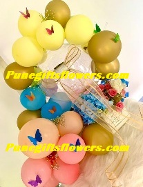 balloons with butterflies and artificial flowers