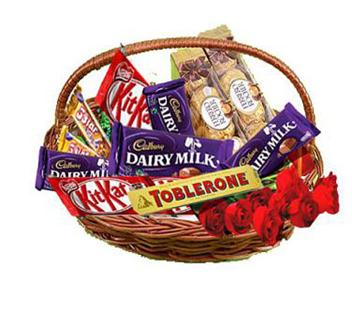 Mix chocolates basket with 5 Red roses