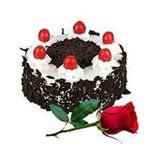 Six Red roses with 1/2 Kg Black Forest Cake