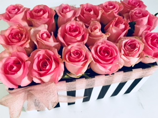 18 pink roses in striped box