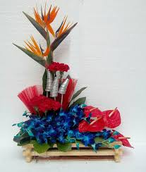 Basket with anthuriums blue orchids and bird of paradise