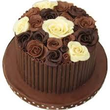 half chocolate cake with chocolate roses on top