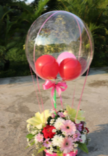 3 Balloons inside a Transparent balloon with basket of 40 flowers