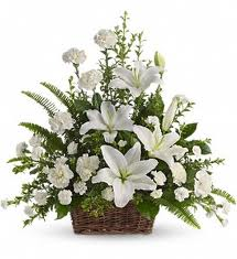 Arrangement of white carnations, roses white Liliums