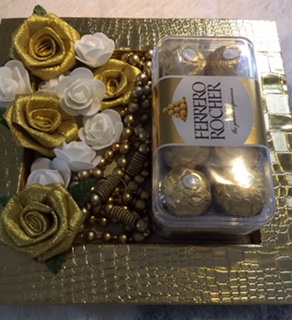 Golden decorated tray with 16 ferrero rocher chocolates