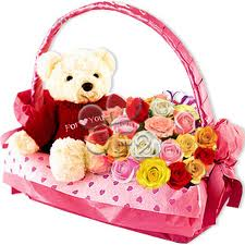 Flowers and teddy in same basket