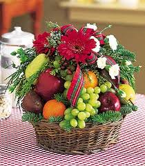 2 kg. fruits with 12 roses in a hand bouquet