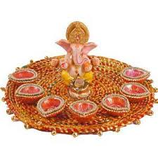 Ganesh ji with 8 diyas in decorated thali