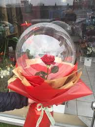 1 transparent balloon 1 red rose arrangement with red wrapping Only for Pune