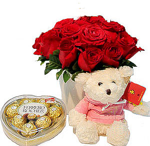 12 Red roses with Heart shaped chocolate box and Teddy (6 Inches)