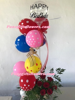 Polka dot balloons arrangement with roses and happy birthday balloon