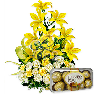 Lilies and ferrero chocolates in a basket