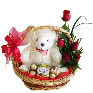 6 Red roses with 16 Ferrero and teddy in same basket